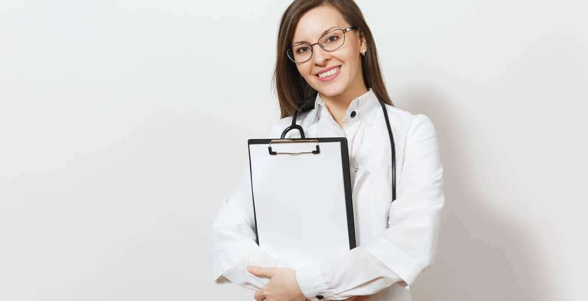 Confident nurse practitioner in white lab coat holding clipboard