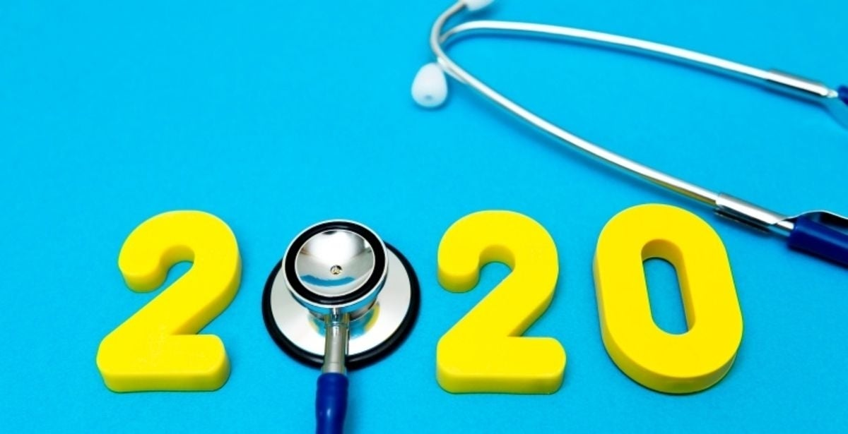 Medical concept of Happy New Year, 2020, with stethoscope on the sky blue background