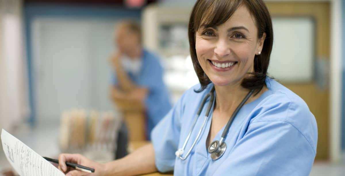 Smiling nurse in hospital setting