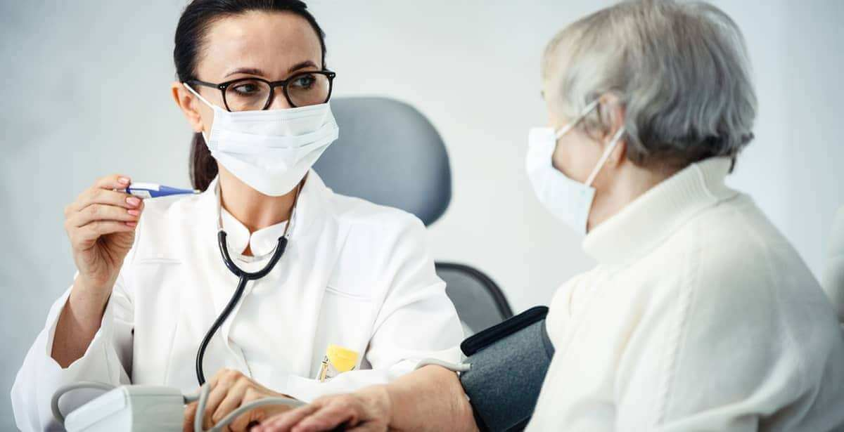 Family nurse practitioner educating her patient