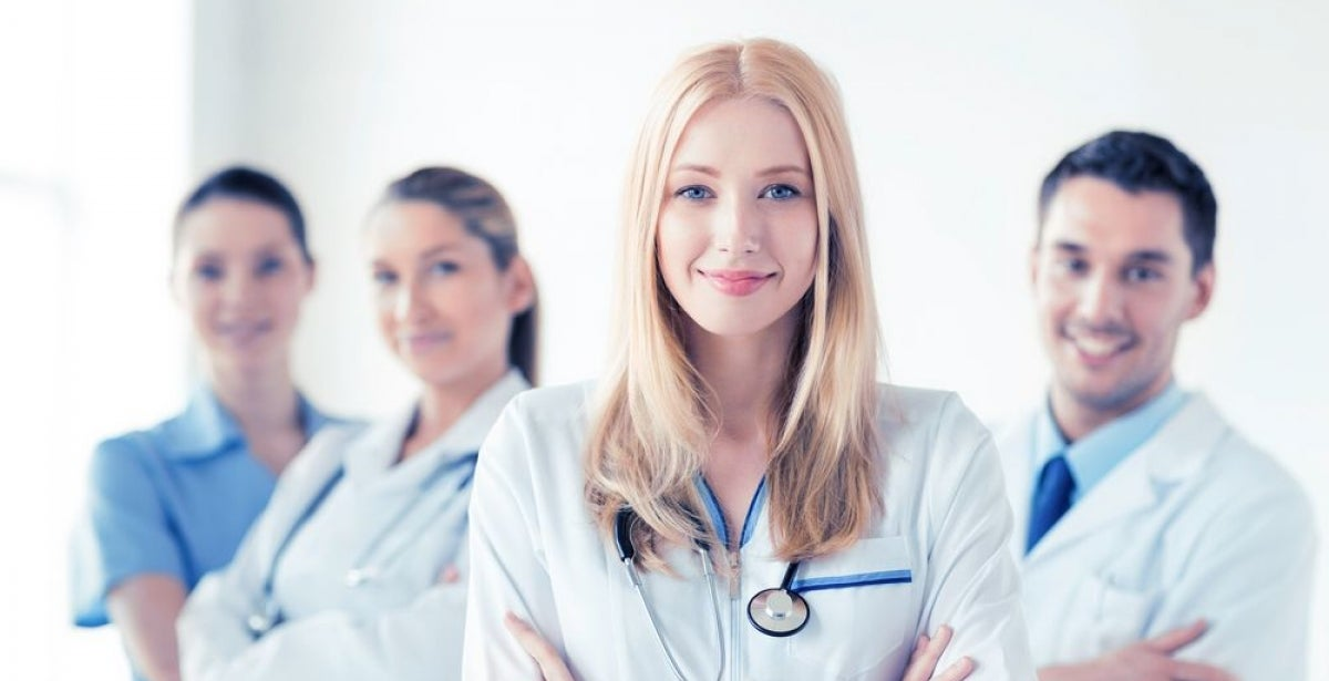 Group of smiling healthcare professionals with arms crossed