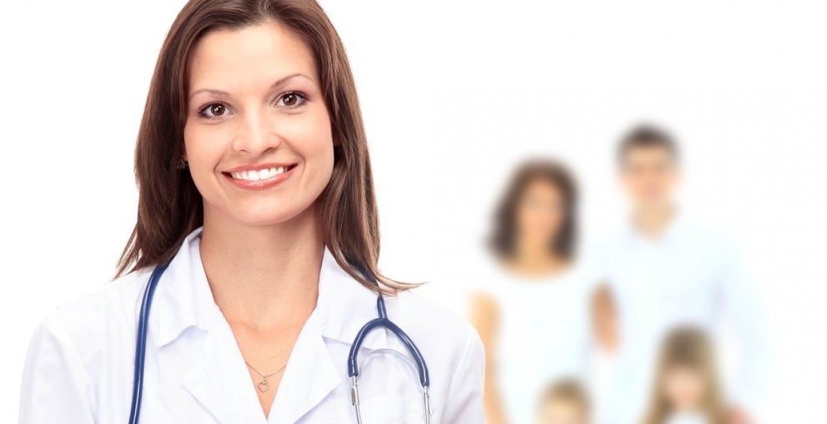 Nurse practitioner smiling with family in the background